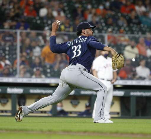 Seattle Mariners starting pitcher Justus Sheffield (33) makes the throw to second base as Myles Straw bunted the ball during the fourth inning of an MLB baseball game at Minute Maid Park, Monday, April 26, 2021, in Houston. Photo: Karen Warren/Staff Photographer / @2021 Houston Chronicle
