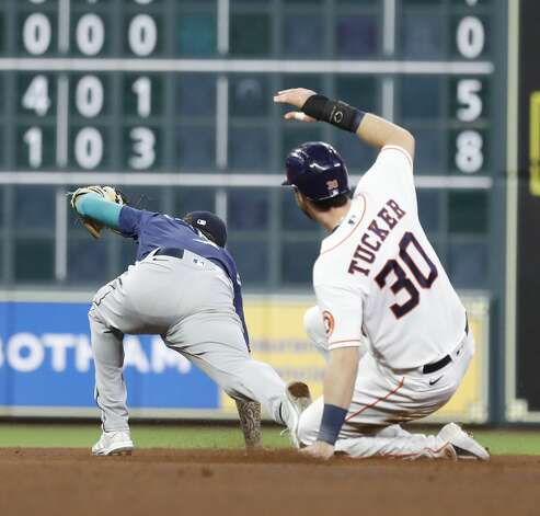 Seattle Mariners shortstop J.P. Crawford (3) tags Houston Astros Kyle Tucker (30) out at second base as Myles Straw bunted the ball during the fourth inning of an MLB baseball game at Minute Maid Park, Monday, April 26, 2021, in Houston. Photo: Karen Warren/Staff Photographer / @2021 Houston Chronicle