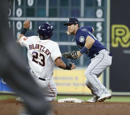 Seattle Mariners second baseman Dylan Moore (25) tags Houston Astros Michael Brantley (23) as Alex Bregman ground into a double play during the third inning of an MLB baseball game at Minute Maid Park, Monday, April 26, 2021, in Houston. Photo: Karen Warren/Staff Photographer / @2021 Houston Chronicle