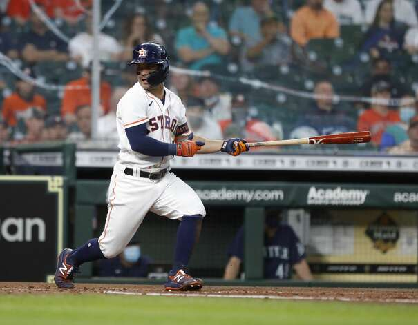 Houston Astros Jose Altuve (27) strikes out against Seattle Mariners starting pitcher Justus Sheffield (33) during the second inning of an MLB baseball game at Minute Maid Park, Monday, April 26, 2021, in Houston. Photo: Karen Warren/Staff Photographer / @2021 Houston Chronicle