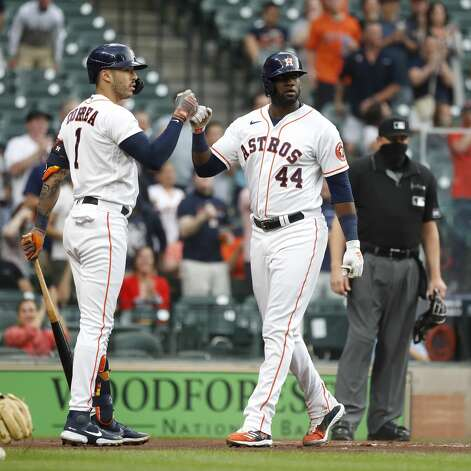 Houston Astros Yordan Alvarez (44) celebrates with Carlos Correa (1) after he scored a run on Yuli Gurriel's RBI single during the first inning of an MLB baseball game at Minute Maid Park, Monday, April 26, 2021, in Houston. Photo: Karen Warren/Staff Photographer / @2021 Houston Chronicle
