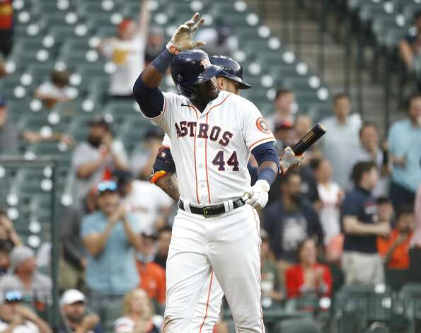 Houston Astros Yordan Alvarez (44) waves to Yuli Gurriel after he scored a run on Gurriel's RBI single during the first inning of an MLB baseball game at Minute Maid Park, Monday, April 26, 2021, in Houston. Photo: Karen Warren/Staff Photographer / @2021 Houston Chronicle