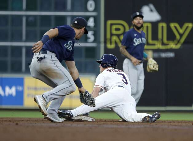 Houston Astros Myles Straw (3) steals second base from Seattle Mariners second baseman Dylan Moore (25) during the second inning of an MLB baseball game at Minute Maid Park, Monday, April 26, 2021, in Houston. Photo: Karen Warren/Staff Photographer / @2021 Houston Chronicle