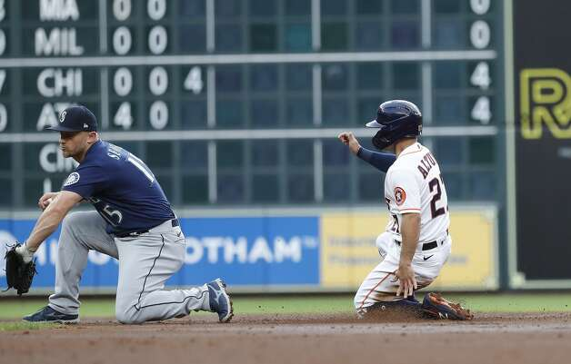 Houston Astros Jose Altuve (27) steals second base from Seattle Mariners Kyle Seager (15) during the first inning of an MLB baseball game at Minute Maid Park, Monday, April 26, 2021, in Houston. Photo: Karen Warren/Staff Photographer / @2021 Houston Chronicle