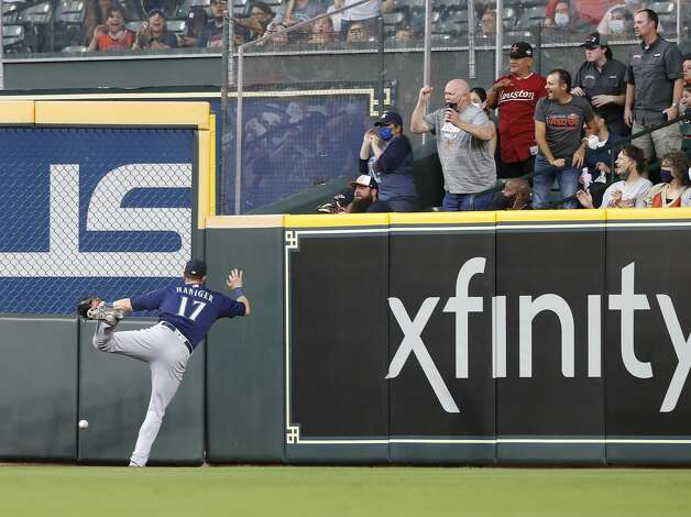 Seattle Mariners right fielder Mitch Haniger (17) chases Houston Astros Yordan Alvarez's RBI double during the first inning of an MLB baseball game at Minute Maid Park, Monday, April 26, 2021, in Houston. Photo: Karen Warren/Staff Photographer / @2021 Houston Chronicle