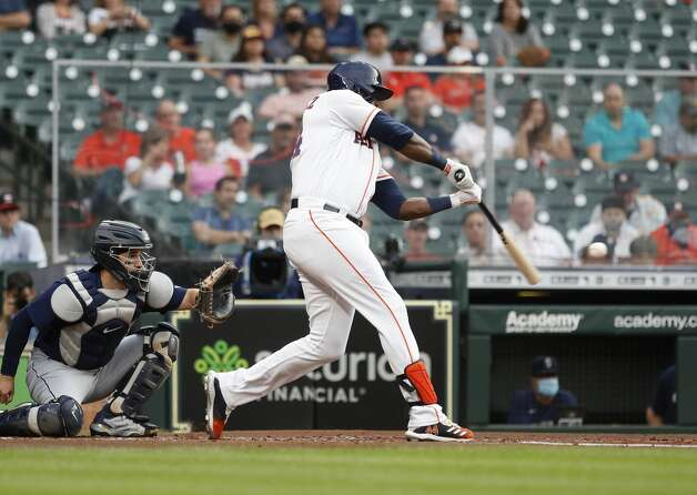 Houston Astros designated hitter Yordan Alvarez (44) hits an RBI double during the first inning of an MLB baseball game at Minute Maid Park, Monday, April 26, 2021, in Houston. Photo: Karen Warren/Staff Photographer / @2021 Houston Chronicle
