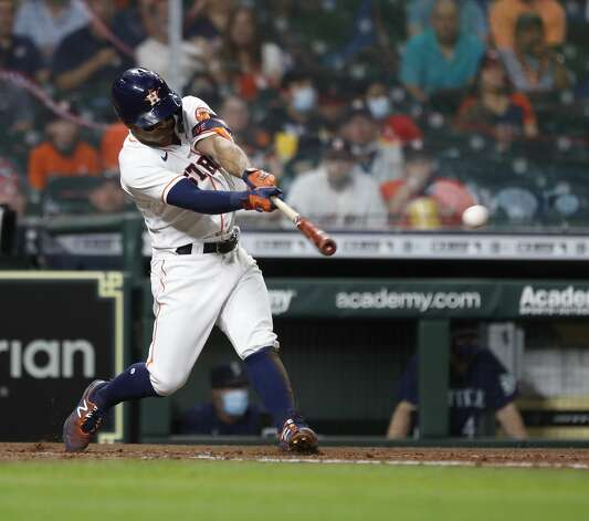 Houston Astros Jose Altuve (27) hits an RBI single off of Seattle Mariners starting pitcher Justus Sheffield (33) during the fourth inning of an MLB baseball game at Minute Maid Park, Monday, April 26, 2021, in Houston. Photo: Karen Warren/Staff Photographer / @2021 Houston Chronicle