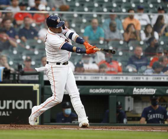 Houston Astros Yuli Gurriel (10) hits an RBI single during the first inning of an MLB baseball game at Minute Maid Park, Monday, April 26, 2021, in Houston. Photo: Karen Warren/Staff Photographer / @2021 Houston Chronicle