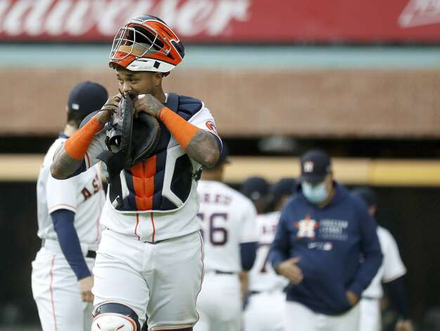 Houston Astros catcher Martin Maldonado (15) bites his glove as he walked to the dugout from the bullpen before the first inning of an MLB baseball game at Minute Maid Park, Monday, April 26, 2021, in Houston. Photo: Karen Warren/Staff Photographer / @2021 Houston Chronicle