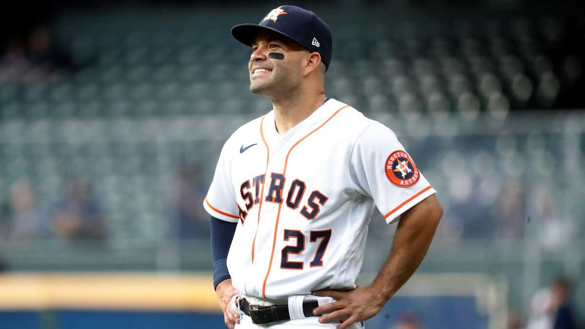 Houston Astros Jose Altuve (27) warms up before the start of the first inning of an MLB baseball game at Minute Maid Park, Monday, April 26, 2021, in Houston.