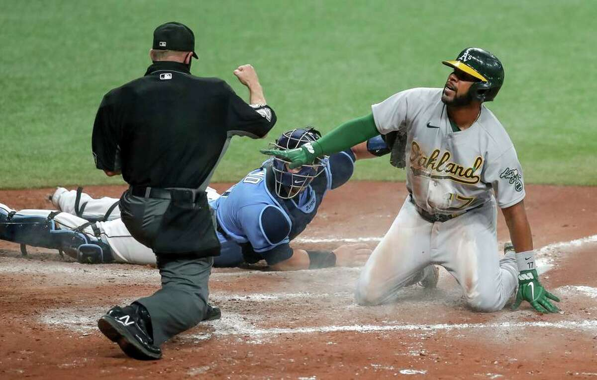 Elvis Andrus of the A's is called out at home following a tag by Rays catcher Mike Zunino in the seventh inning.