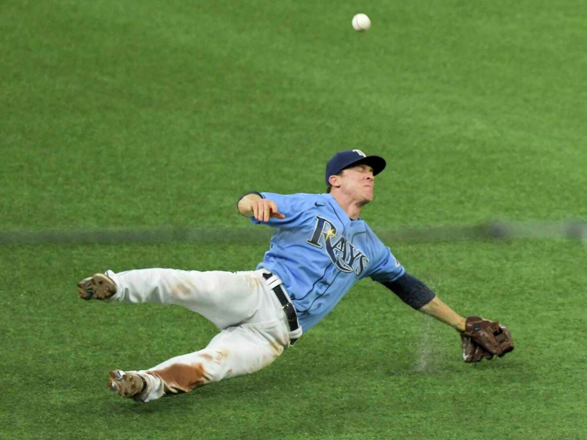 Tampa Bay Rays third baseman Joey Wendle misplays a pop fly ball during the seventh inning of a baseball game Monday, April 26, 2021, in St. Petersburg, Fla. (AP Photo/Steve Nesius)