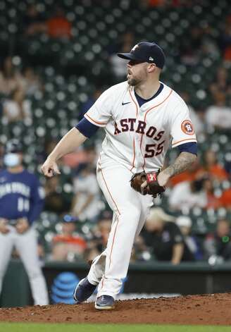 Houston Astros relief pitcher Ryan Pressly (55) pitches during the ninth inning of an MLB baseball game at Minute Maid Park, Monday, April 26, 2021, in Houston. Photo: Karen Warren/Staff Photographer / @2021 Houston Chronicle
