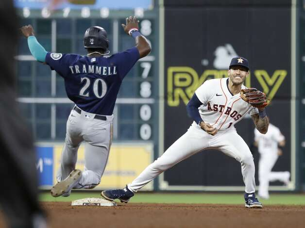 Houston Astros shortstop Carlos Correa (1) tries to turn the double play on Seattle Mariners Sam Haggerty but was unable to after tagging Taylor Trammell during the ninth inning of an MLB baseball game at Minute Maid Park, Monday, April 26, 2021, in Houston. Photo: Karen Warren/Staff Photographer / @2021 Houston Chronicle