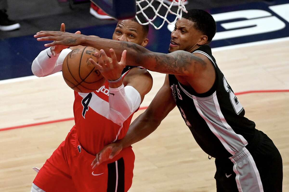 Rudy Gay knocks the ball from Russell Westbrook on Monday, April 26, 2021. MUST CREDIT: Washington Post photo by Katherine Frey