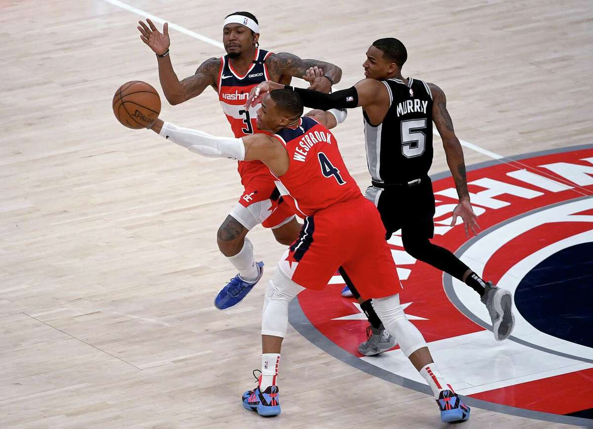 Russell Westbrook and Bradley Beal try to play keep-away from Dejounte Murray on Monday, April 26, 2021. MUST CREDIT: Washington Post photo by Katherine Frey