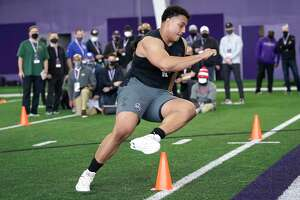 Northwestern offensive lineman Rashawn Slater, participates in the school's Pro Day football workout on March 9, 2021, in Evanston, Ill.