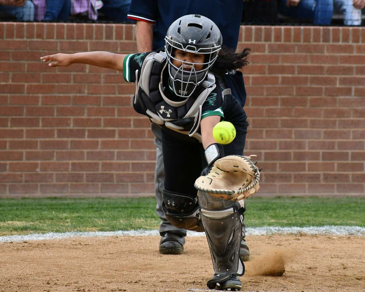 Floydada catcher Marissa Obregon tries to snatch a popup during a softball game against Plainview on Monday at Lady Bulldog Park.