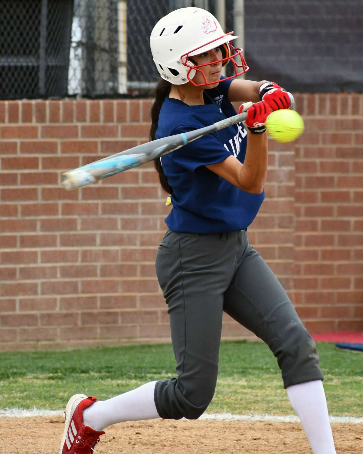 Plainview's Mikayla Carrillo looks to connect on a pitch.