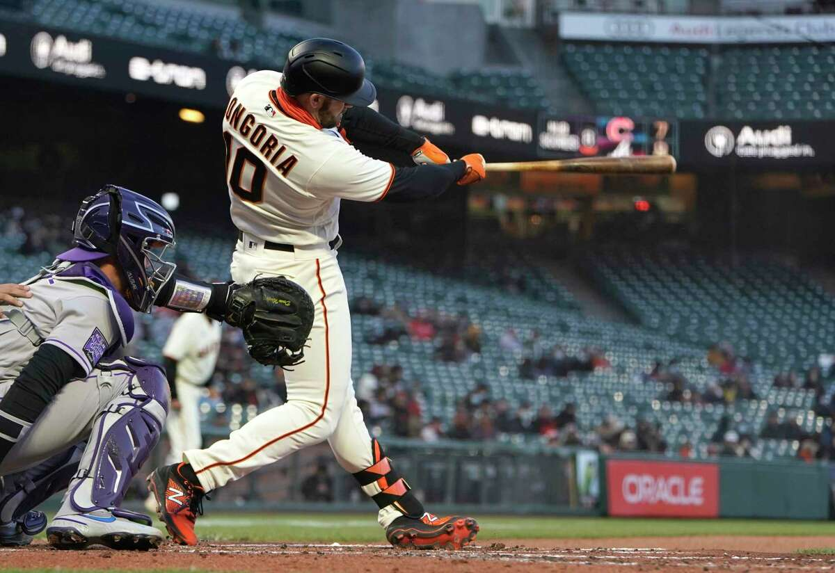 SAN FRANCISCO, CALIFORNIA - APRIL 26: Evan Longoria #10 of the San Francisco Giants hits a two-run double against the Colorado Rockies in the second inning at Oracle Park on April 26, 2021 in San Francisco, California. (Photo by Thearon W. Henderson/Getty Images)