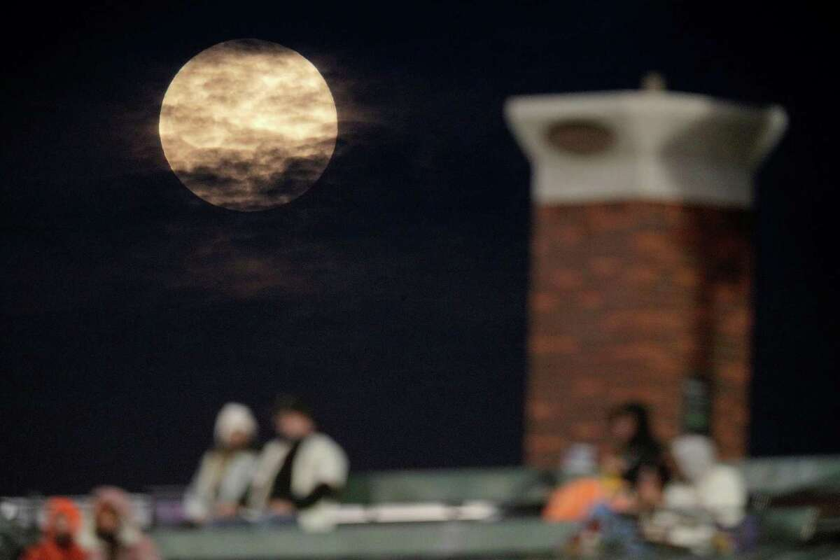 The Pink Super Moon rises over Levi's Landing as the San Francisco Giants played the Colorado Rockies at Oracle Park in San Francisco Calif., on Monday, April 26, 2021.