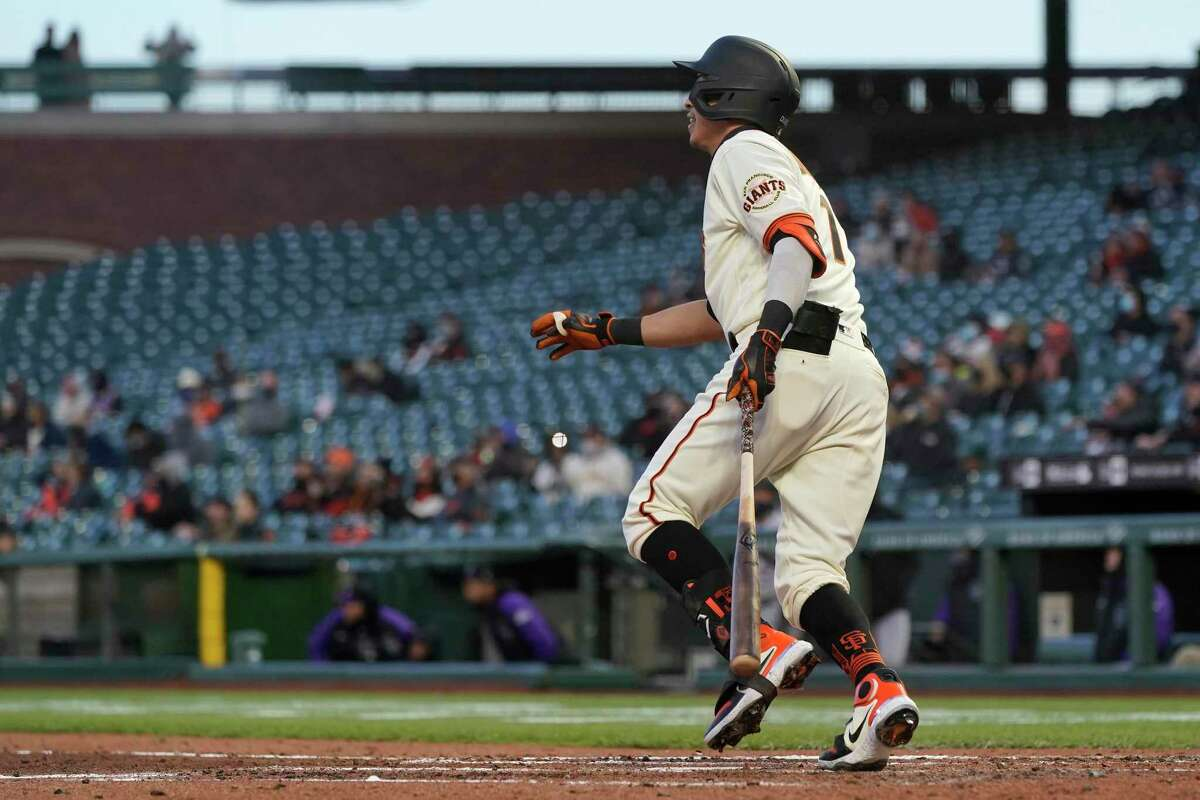 San Francisco Giants' Mauricio Dubon watches his three-run double against the Colorado Rockies during the second inning of a baseball game in San Francisco, Monday, April 26, 2021. (AP Photo/Jeff Chiu)