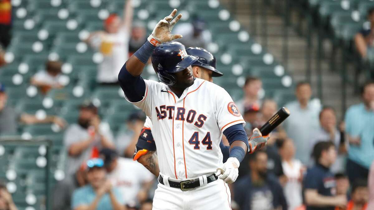 Houston Astros Yordan Alvarez (44) waves to Yuli Gurriel after he scored a run on Gurriel's RBI single during the first inning of an MLB baseball game at Minute Maid Park, Monday, April 26, 2021, in Houston.