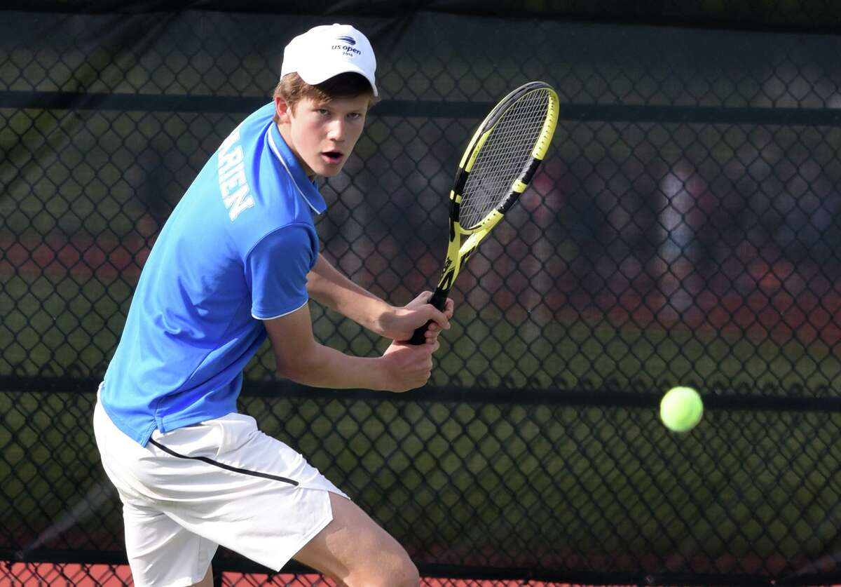 Darien's Chris Calderwood lines up a backhand shot during a boys tennis match in New Canaan on Thursday, May 23, 2019.