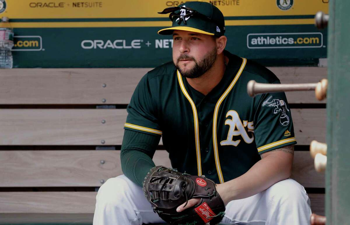 The A's Yonder Alonso in the dugout before the start of the game, as the Oakland Athletics prepare to take on the Chicago White Sox at the Oakland Coliseum on Wednesday July 5, 2017, in Oakland, Ca.