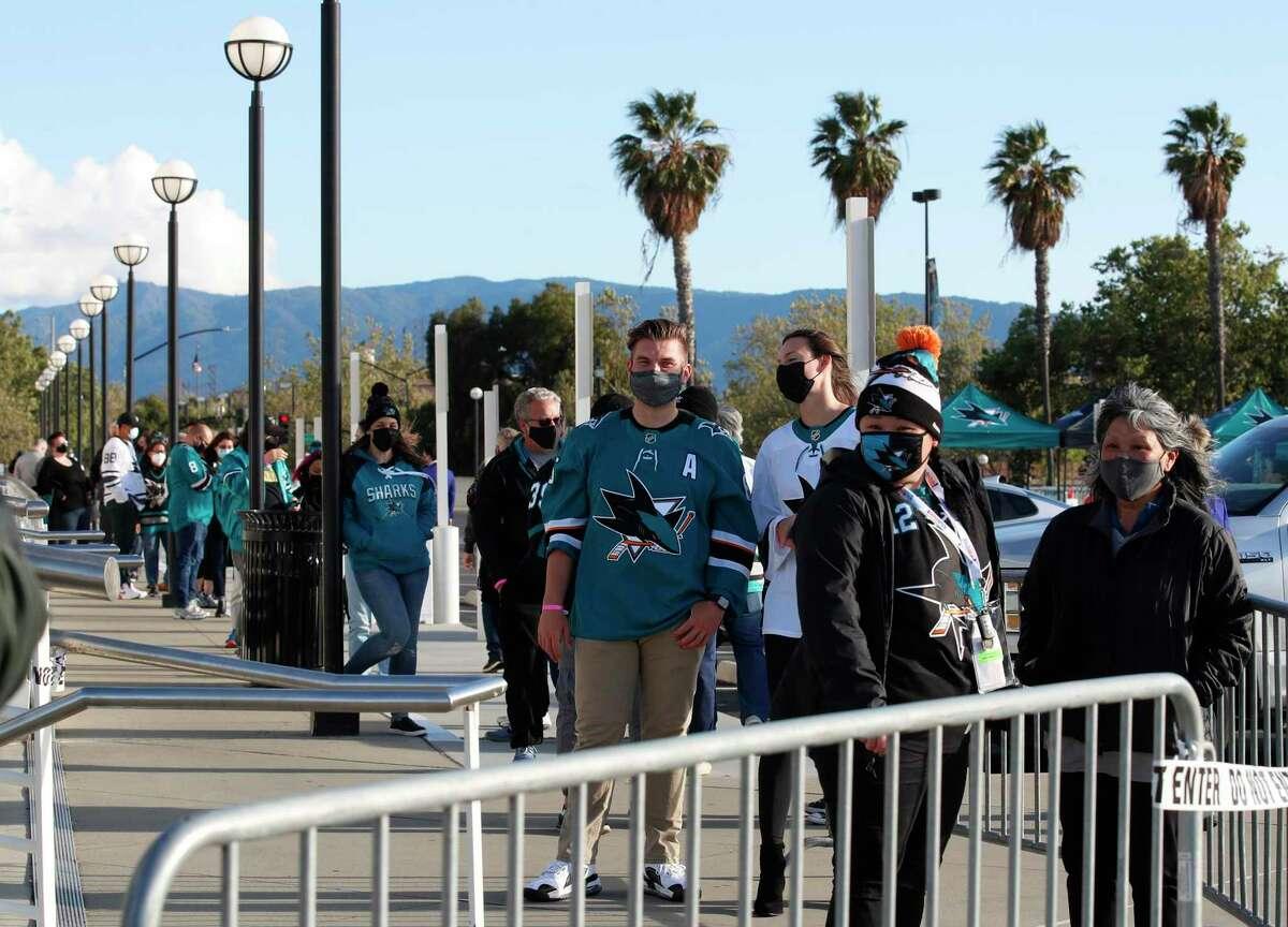 Hockey fans enter SAP Center before an NHL game between San Jose Sharks and Arizona Coyotes in San Jose, Calif., Monday, April 26, 2021. (AP Photo/Josie Lepe)