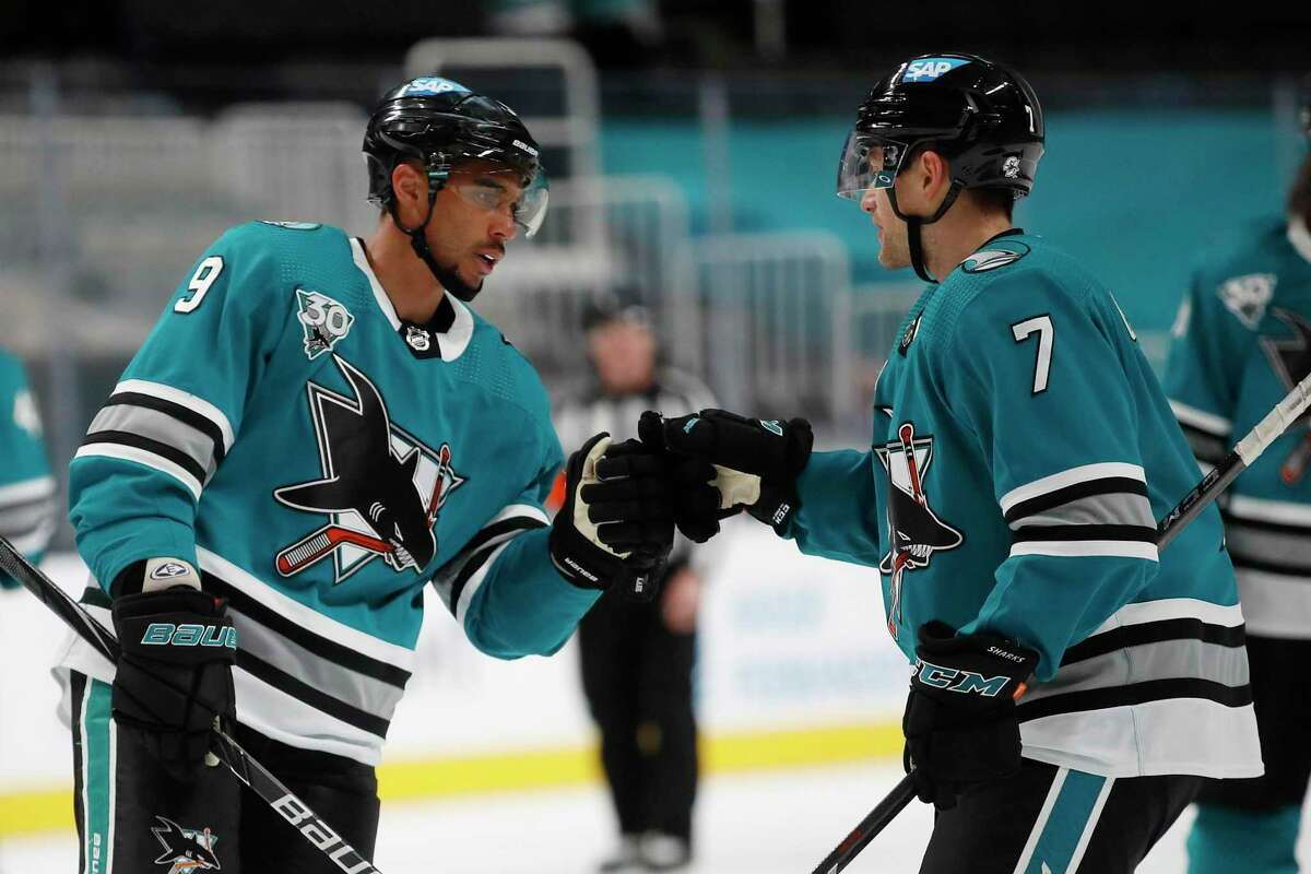 San Jose Sharks center Dylan Gambrell (7) celebrates with Dylan Gambrell (7) after beating the Arizona Coyotes during the third period of an NHL hockey game in San Jose, Calif., Monday, April 26, 2021. (AP Photo/Josie Lepe)