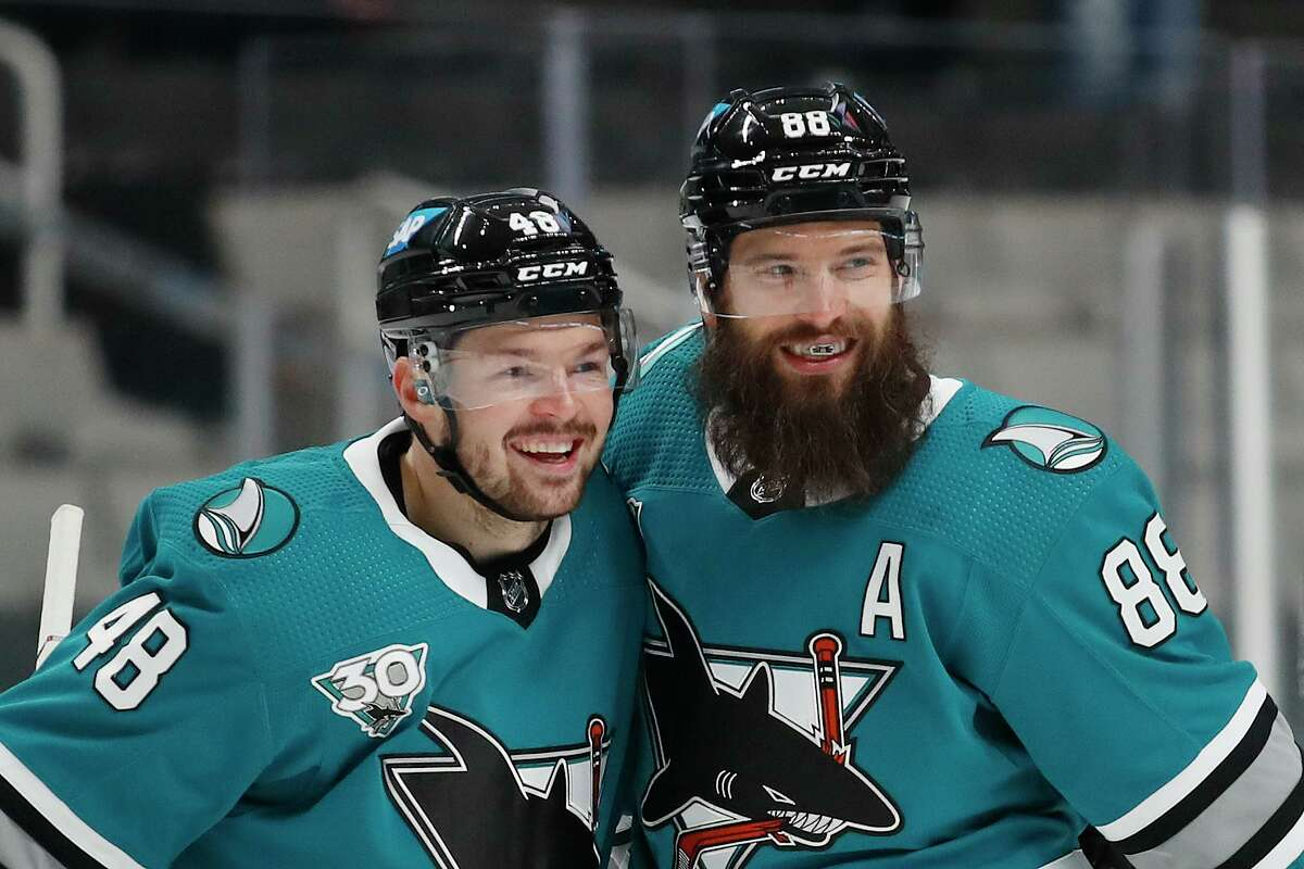 San Jose Sharks center Tomas Hertl (48) celebrates with defenseman Brent Burns (88), who scored a goal against the Arizona Coyotes during the first period of an NHL hockey game in San Jose, Calif., Monday, April 26, 2021. (AP Photo/Josie Lepe)