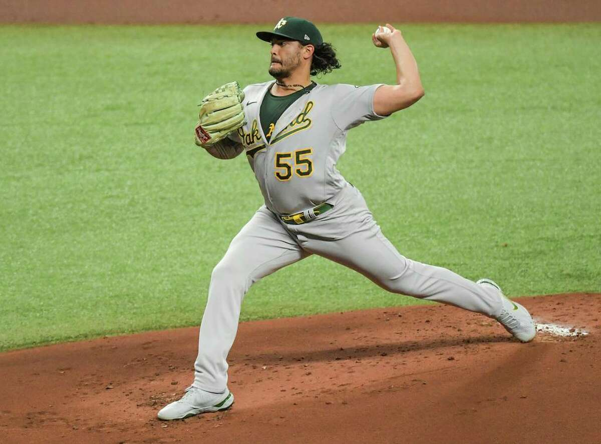 Oakland Athletics starter Sean Manaea pitches against the Tampa Bay Rays during the first inning of a baseball game Monday, April 26, 2021, in St. Petersburg, Fla. (AP Photo/Steve Nesius)