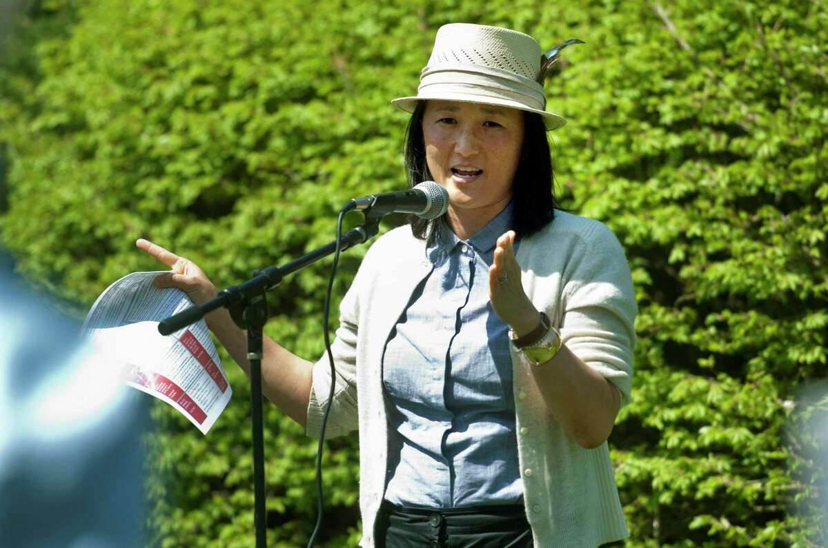 """State Rep. Kimberly Fiorello (R- Greenwich, Stamford) speaks during CT 169 Strong's """"Hands Off Our Zoning"""" rally at Ballard Park in Ridgefield, Conn., on Saturday April 24, 2021."""