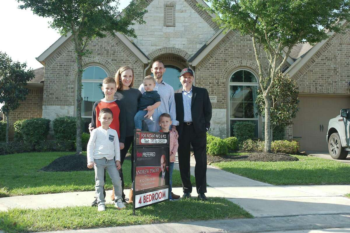 Real estate broker Andrew Pikoff, right, says a variety of factors are contributing to the strong seller's market in Pearland for homes. Clients Amy and Chuck Marshall, shown with their children Hank, Weston, Clint and Luke, put their house on the market in the city.