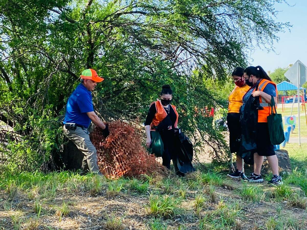 Around 90 volunteers gathered to hold a trash cleanup in the Santa Fe subdivision on Saturday in celebration of Earth Day.