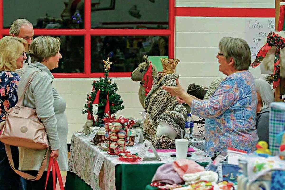 A vendor selling knitted goods at the 2019 Holly Berry Fair. The Caseville Library Club, which had been the fair's organizer, have passed on those duties to the Caseville Public School.