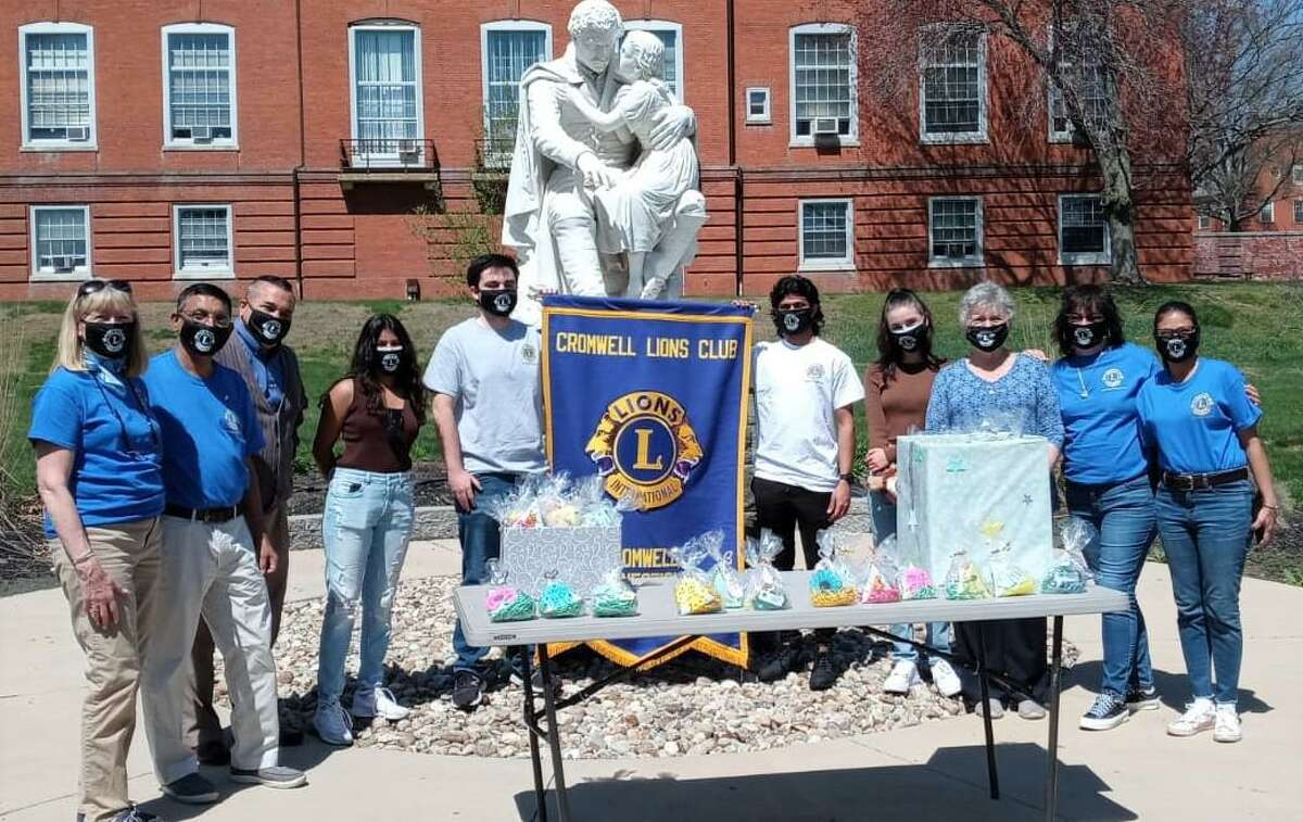 Members of the Cromwell Lions Club gather during a recent fundraising event.