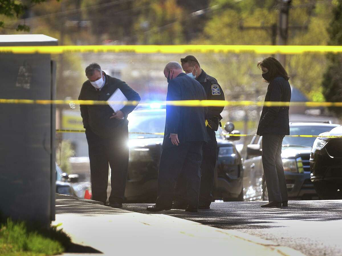 The scene of a 7 am police shooting involving a Derby police officer on Division Street in Ansonia on Monday. Division Street marks the border between Ansonia and Derby.