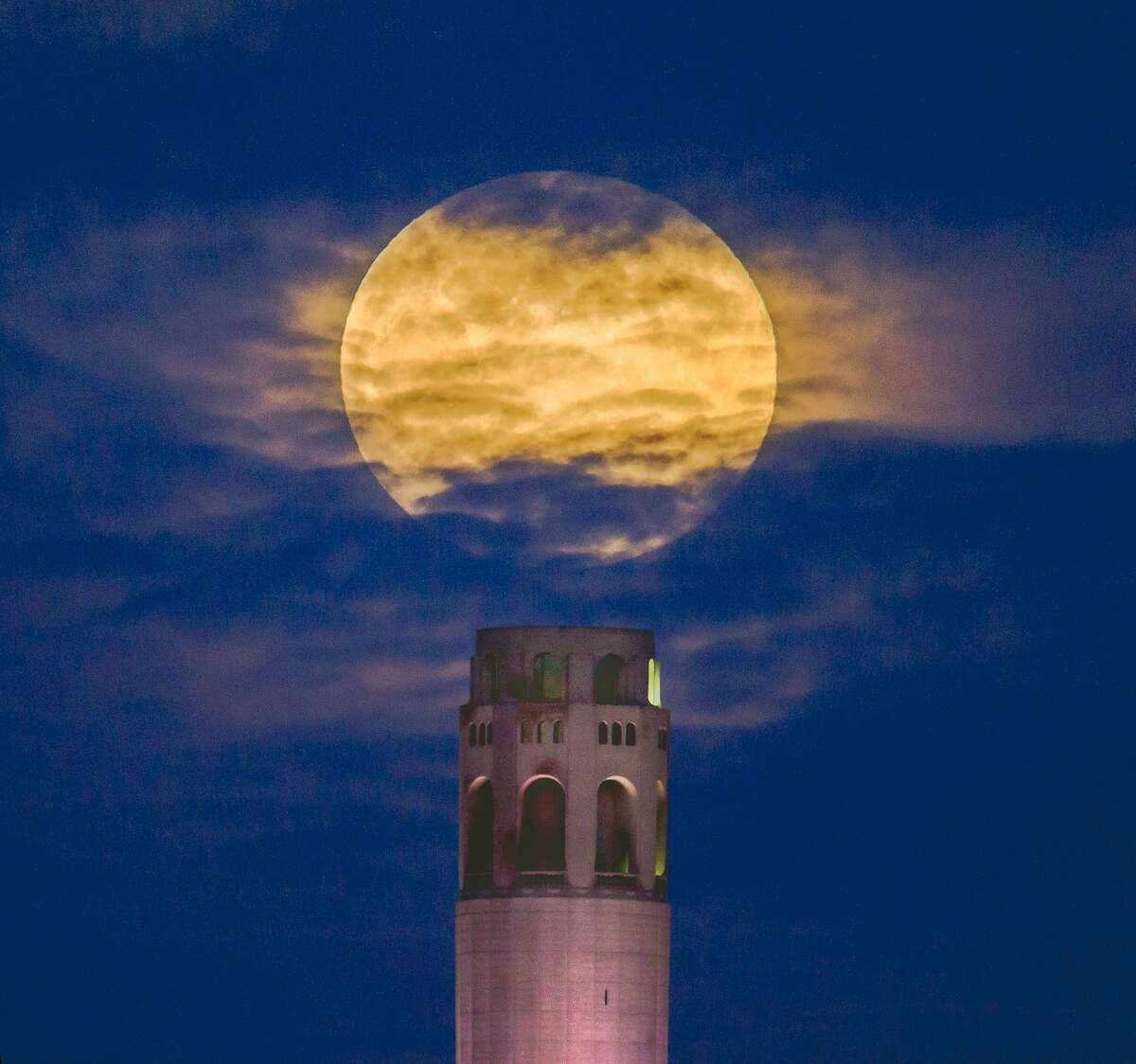 Frederic Larson, @mysticalphoto, photographed April's supermoon in the night sky over Coit Tower in San Francisco on Monday evening, April 26, 2021.