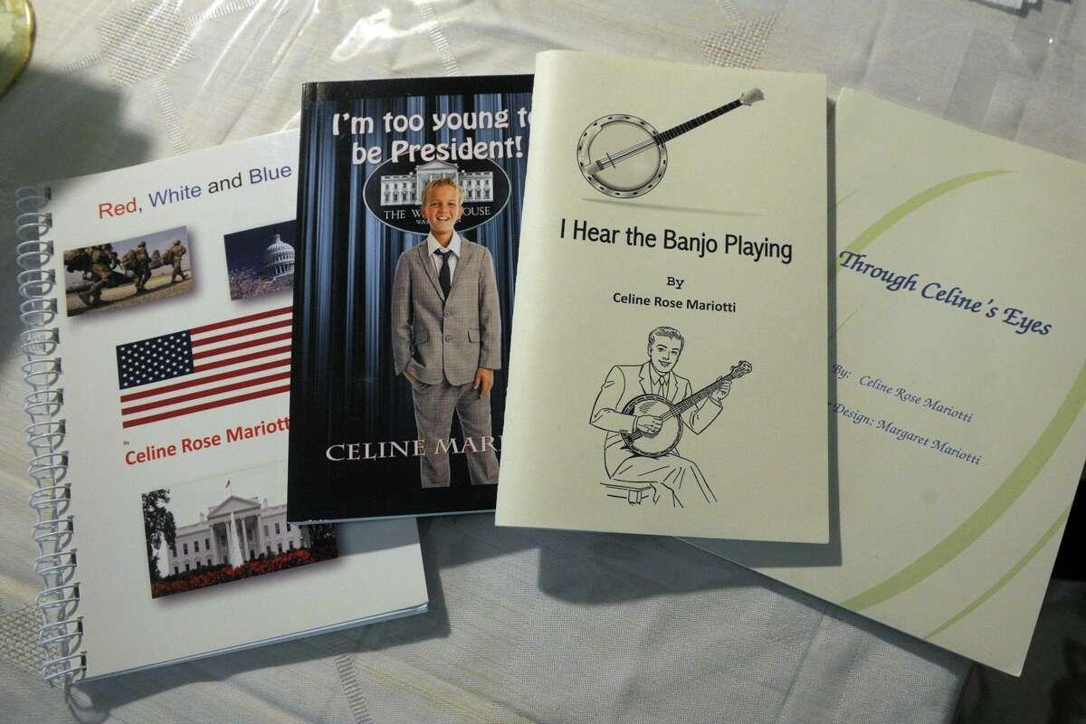 A couple of Celine Mariotti's self-published books in her Shelton, Conn. home April 26, 2021.