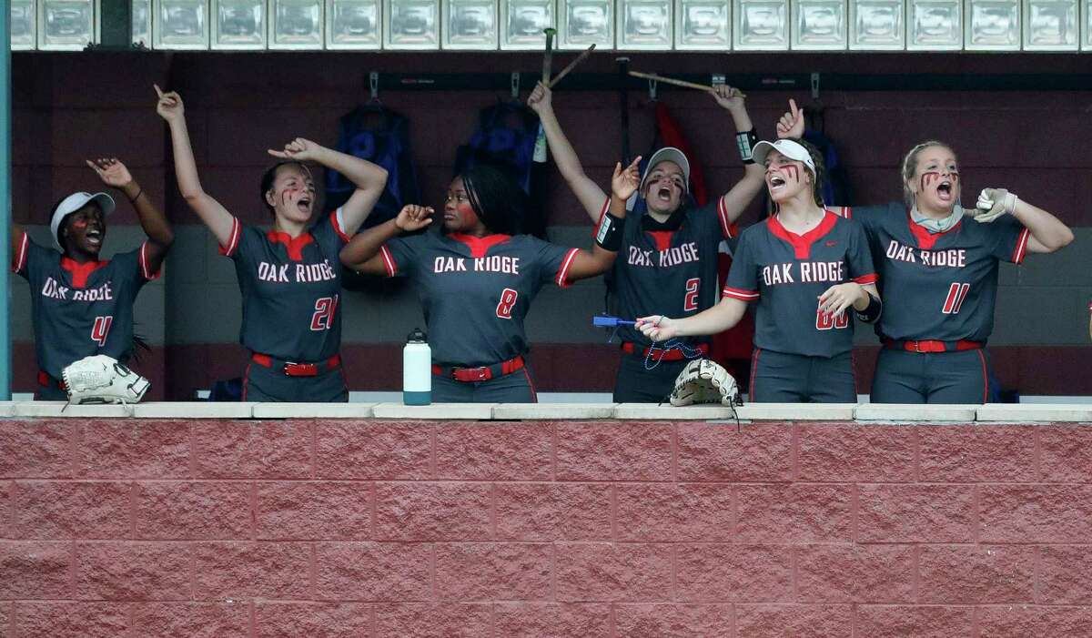 Oak Ridge players cheer after Alyssa Lyons' 2-RBI double during the first inning of a District 13-6A high school softball game at Willis High School, Friday, April 16, 2021, in Willis.