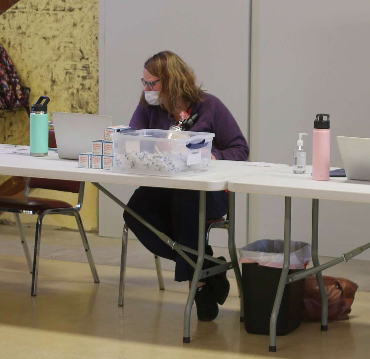 District Health Department #10 immunizations coordinator Bethanie Dean works during a COVID-19 vaccination clinic held at the Wagoner Community Center on Friday. (Kyle Kotecki/News Advocate)