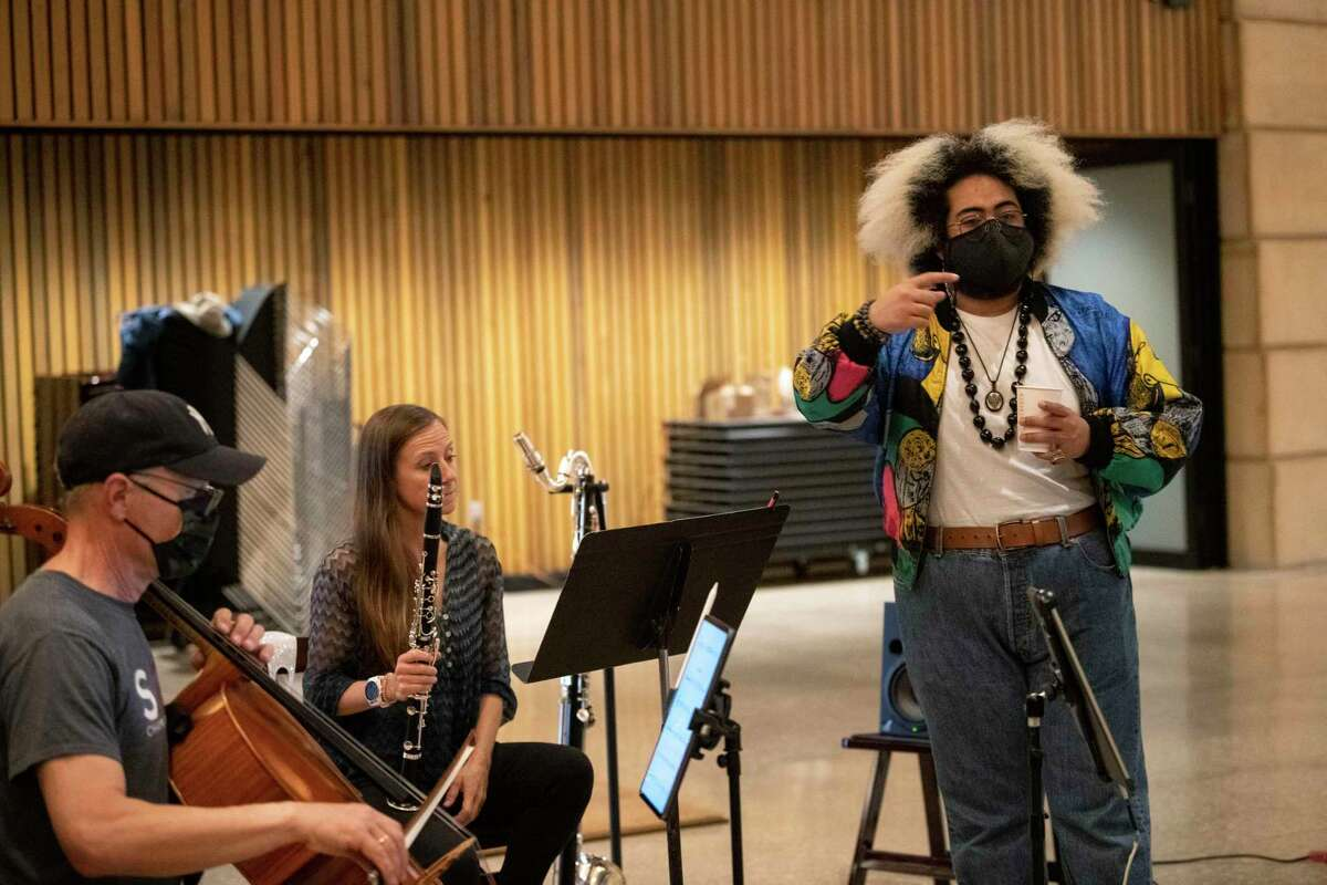 """Composer Darian Donovan Thomas, standing, takes part in a rehearsal for """"((HERE))"""" with the SOLI Chamber Ensemble."""
