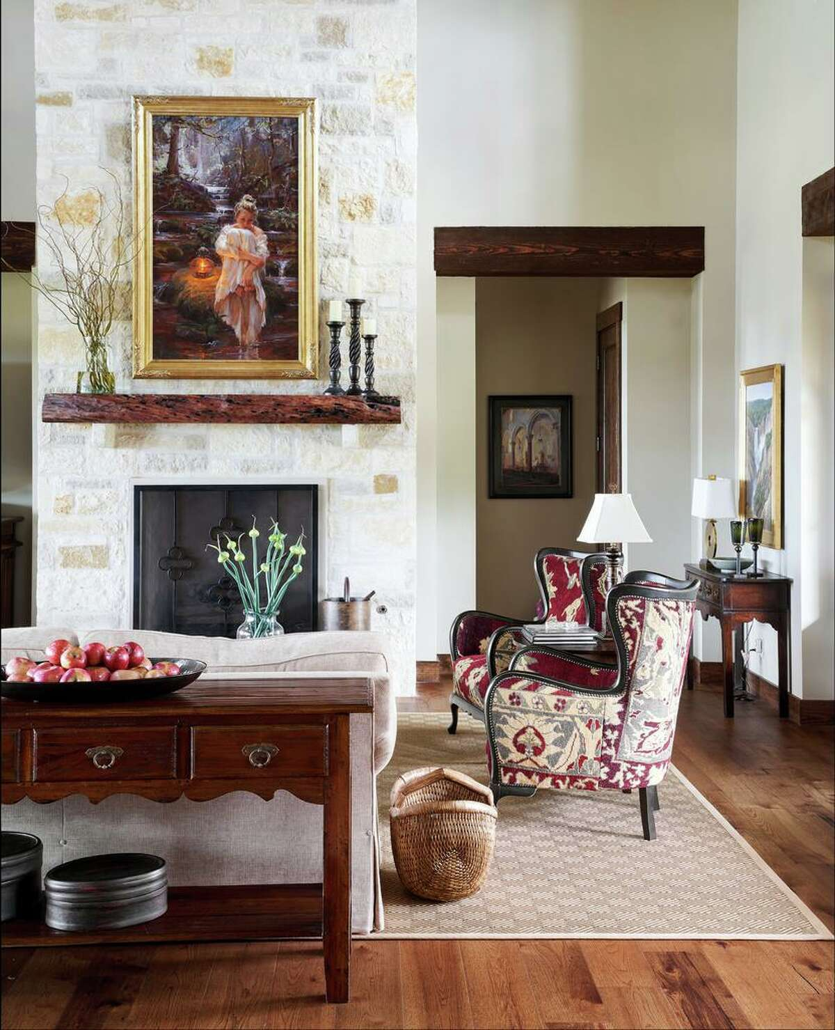 They reupholstered furniture that had been in their Santa Fe home from pieces that worked in an adobe style vacation home to Hill Country casual elegance.