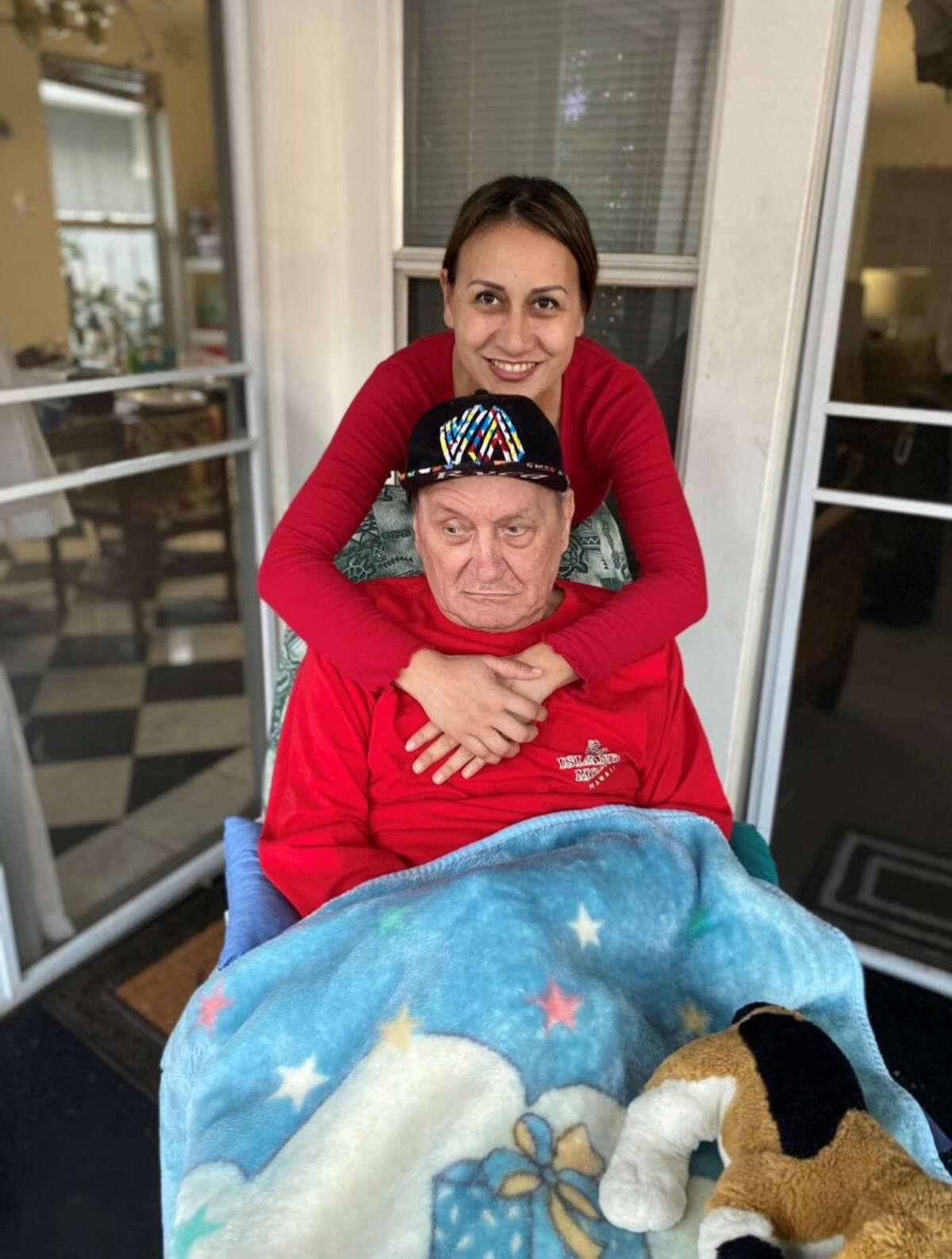 Poki'i Balaz with her father, John Balaz, in their home in Aiea, Hawaii.