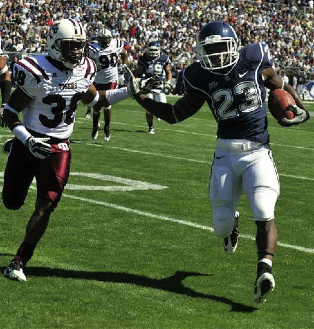 Connecticut's Jordan Todman (23) is pursued by Texas Southern's Zach Gallow during the first half of an NCAA college football game in East Hartford, Conn., Saturday, Sept. 11, 2010. (AP Photo/Jessica Hill)