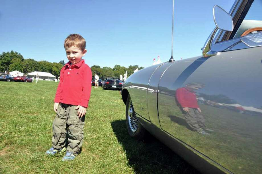 Billy Stammer, 4, of Weston, stands next to a 1969 E-type Jaguar during the Fairfield County Concours d'Elegance car and motorcycle club at Fairfield County Hunt Club on Long Lots Road in Westport on Saturday, Sept. 11, 2010. Photo: Amy Mortensen / Connecticut Post Freelance