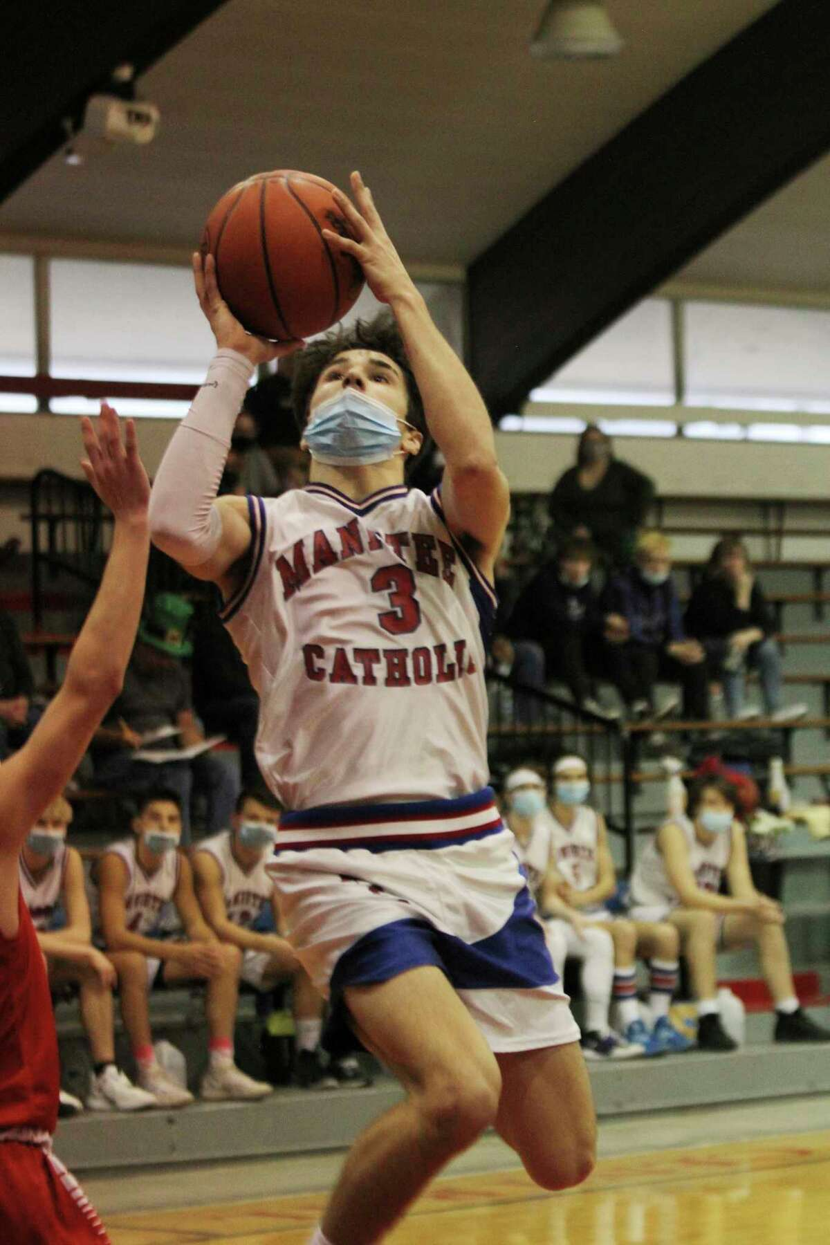 Manistee Catholic Central's Mateo Barnett averaged 17.4 points, five rebounds and 3.5 assists a game throughout the season. (News Advocate file photo)