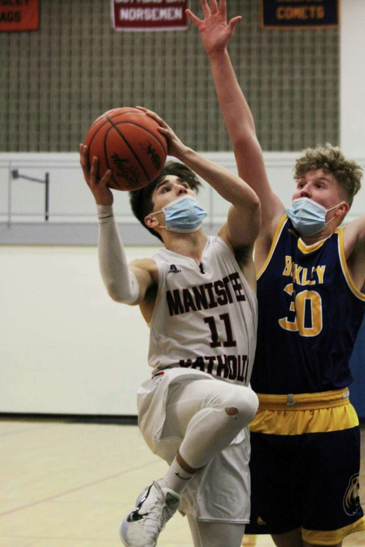 Manistee Catholic Central senior Mateo Barnett was named an All-State honorable mention in Division 4 boys basketball. (News Advocate file photo)